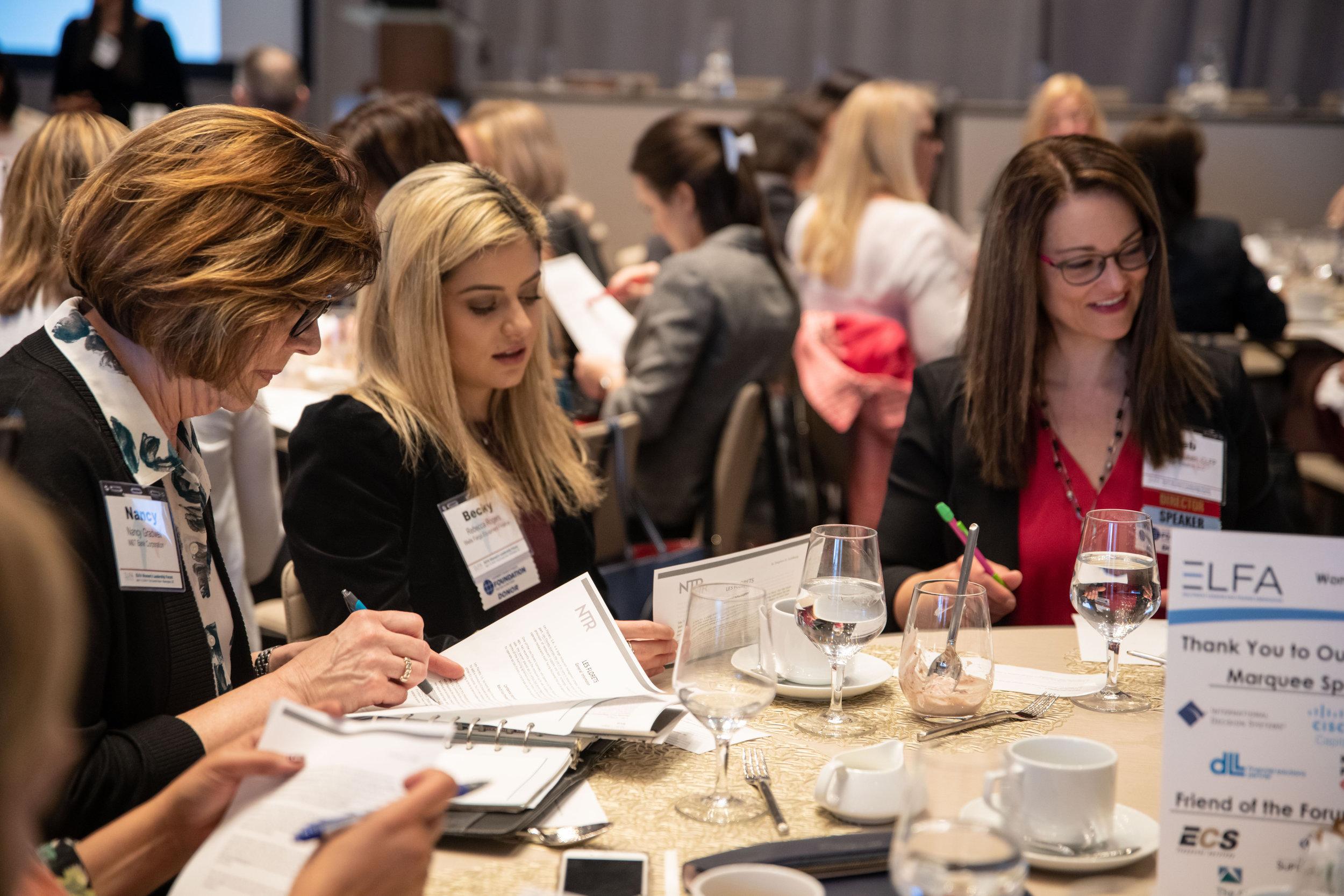 (L-R) Nancy Gradwell, Rebecca Rogers, and Deborah Reuben roleplay at a Women's Leadership Forum workshop