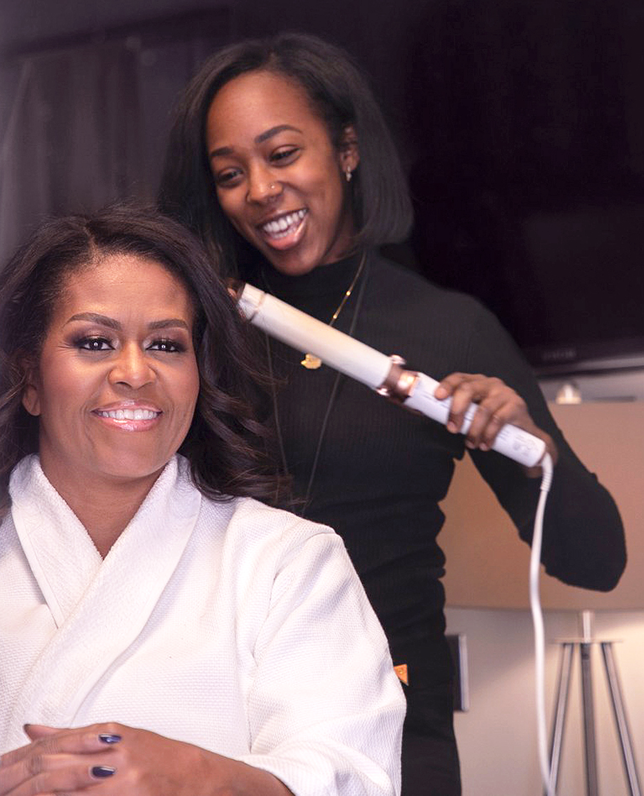 Yene styling First Lady Obama for a press event.