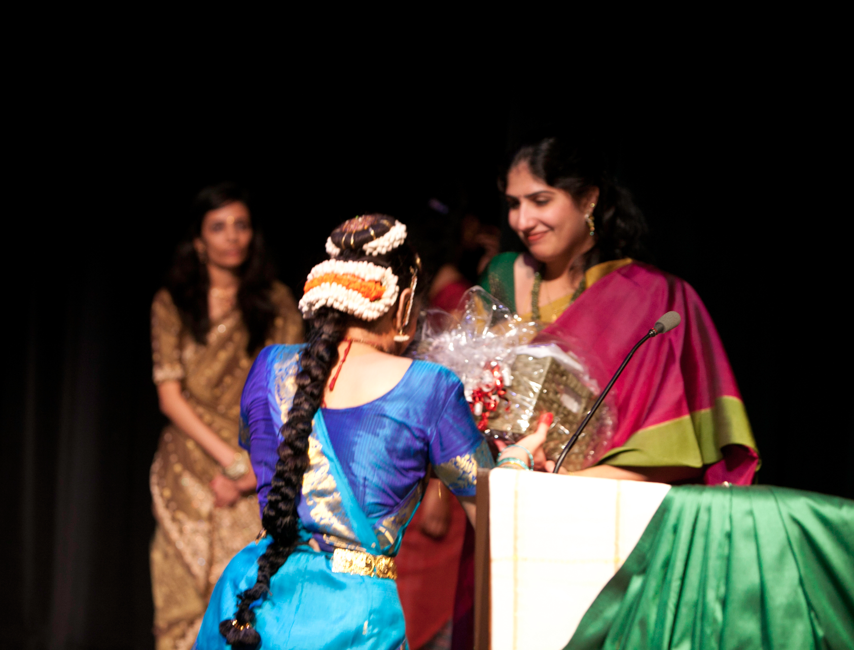 Siddhi Patel, Silambam's first Ranga Pravesham student, presents her Guru with a token of appreciation at her debut performance in 2011. You can also find Siddhi (now Siddhi Aryan) on our ' Supporters ' page, listed under 'Gold Donors', in recognition of her extraordinary contirbution of architectural design services to Silambam.