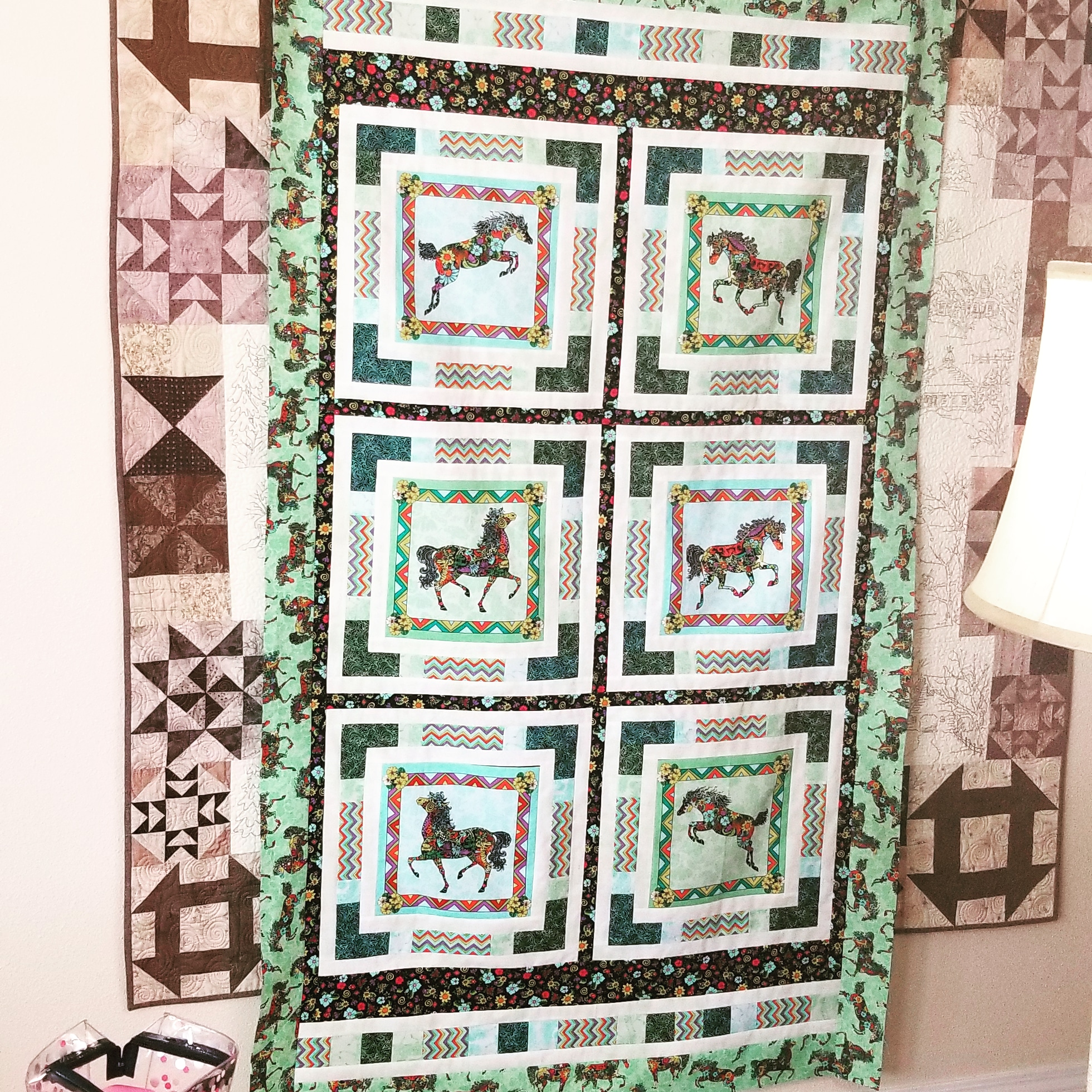 Mom's new quilt. This photo is a little washed out.