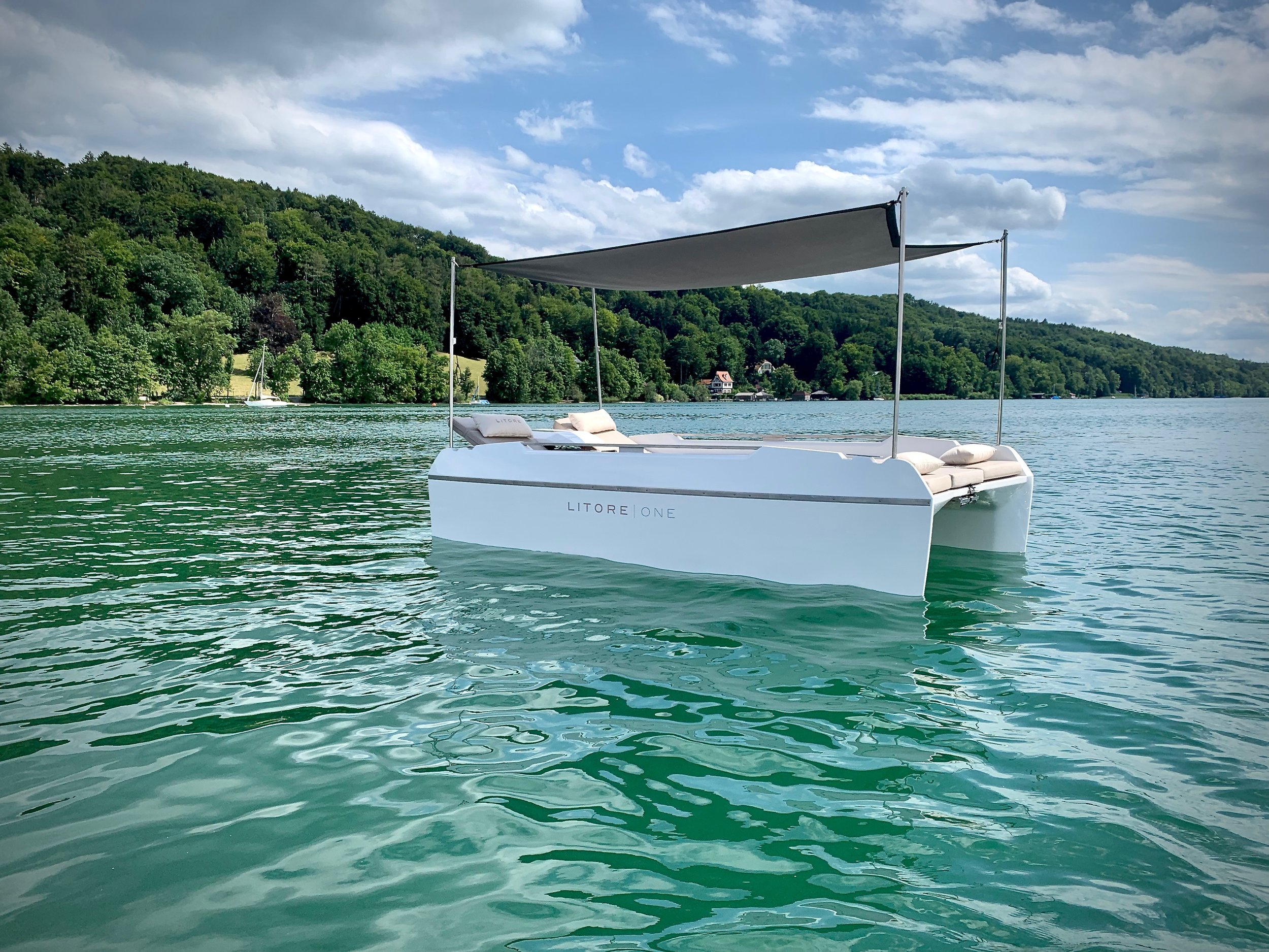 INTRODUCING LITORE ONE - Litore one is the first electric day-cruiser powered by Torqeedo Travel motor. The elegant multihull combines the space and comfort up to 5 people with a range suitable for everyday use, catapulting the passengers into a new era of easy boating.