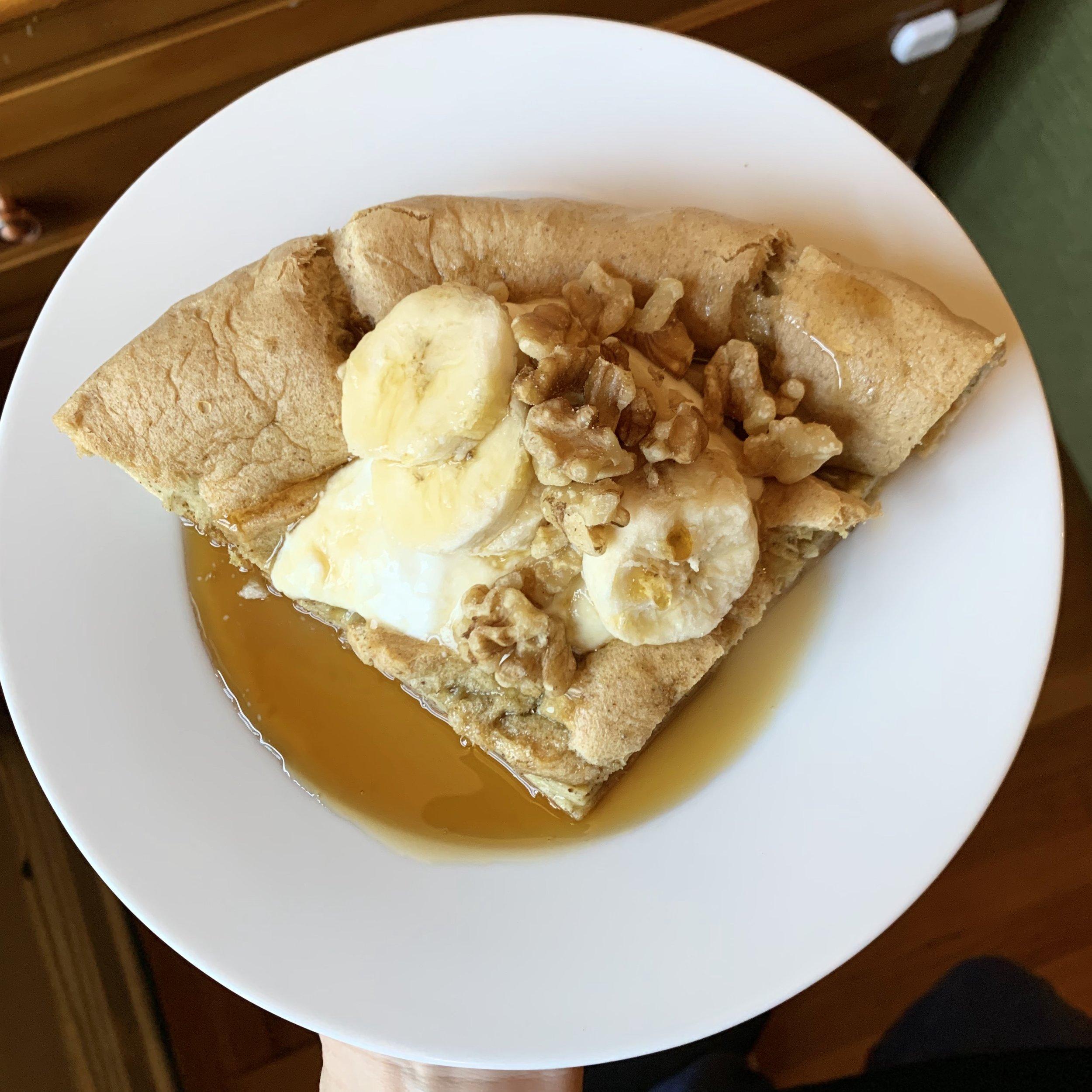 Topped with plain yogurt, banana, walnuts, and maple syrup.