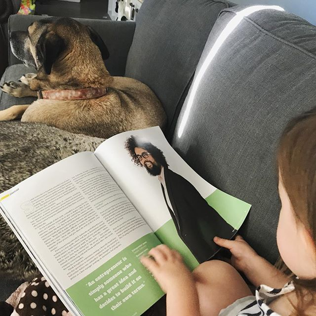 Kate spends her Monday morning reading the July issue of @comstocksmag to Henry. #toddlerkate #henrydog
