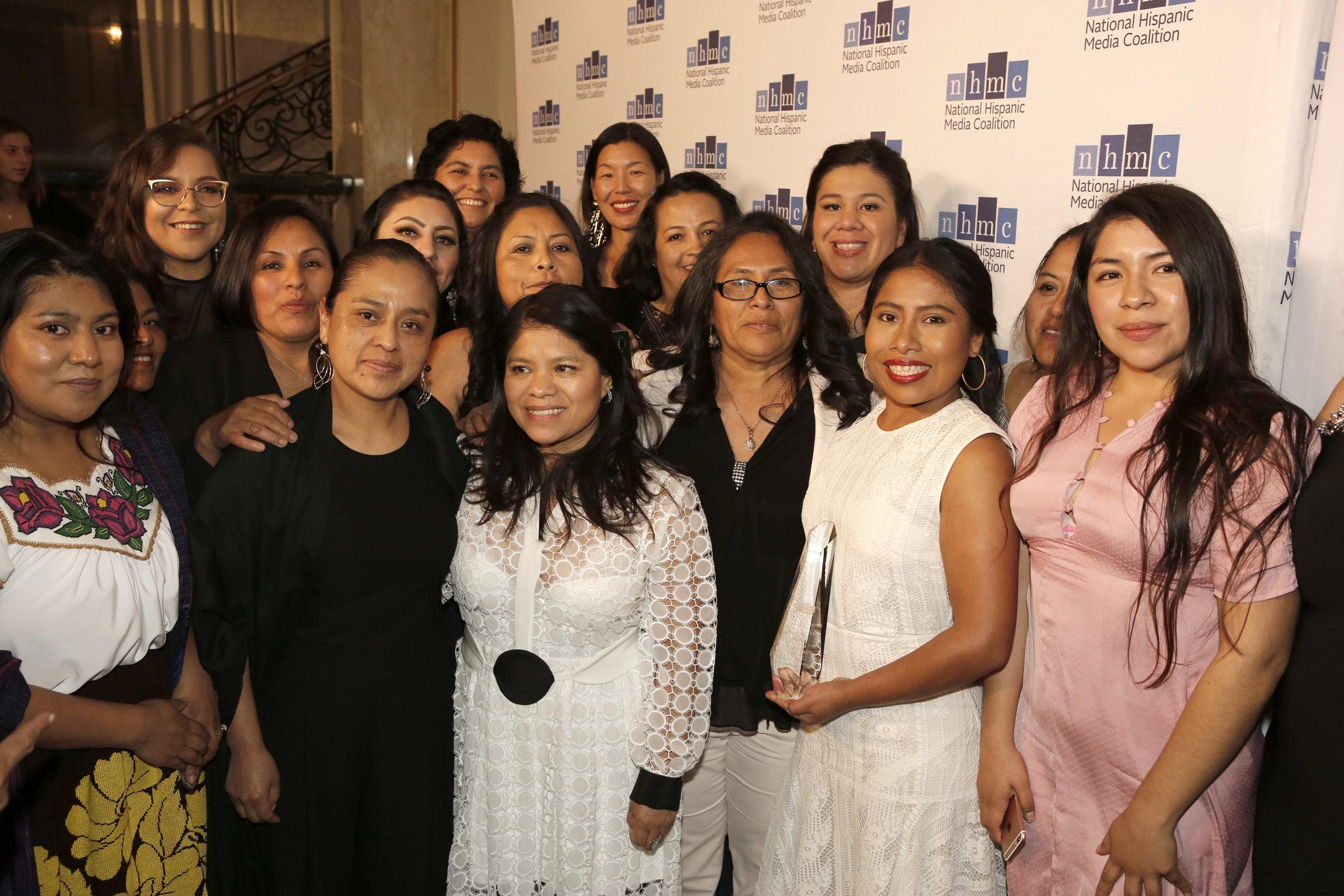 Yalitza Aparicio holding the Impact Award for Oustanding Performance in a Film, 2.22.19 © 2019, National Hispanic Media Coalition.jpg