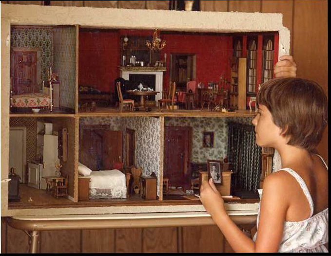 The model of 221B Baker Street created by Dorothy Shaw. Image by Fred Rick, Los Alamos, New Mexico. The young lady is his daughter. (1980's)