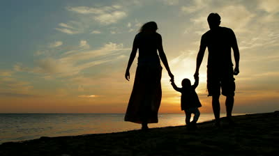 stock-footage-happy-family-walking-on-sea-coast-silhouettes-sunset.jpg
