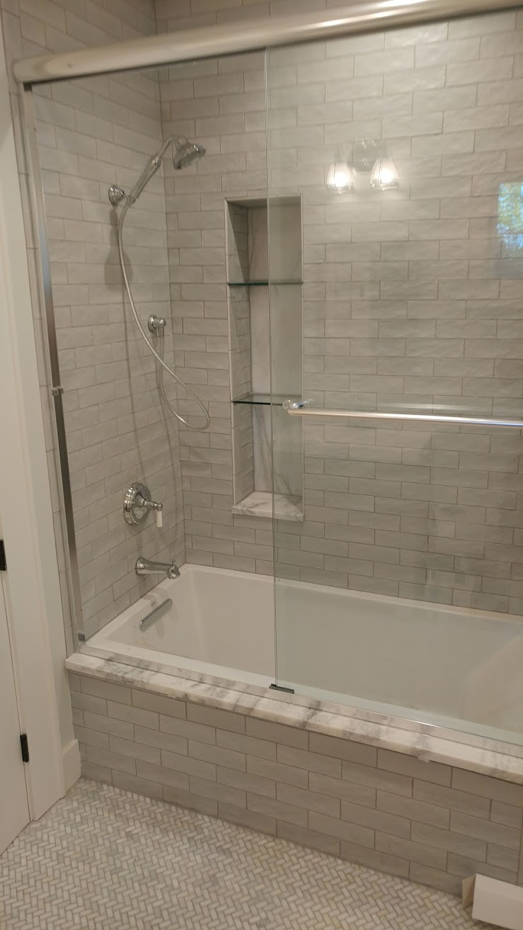 Guest bath with glass shelves.