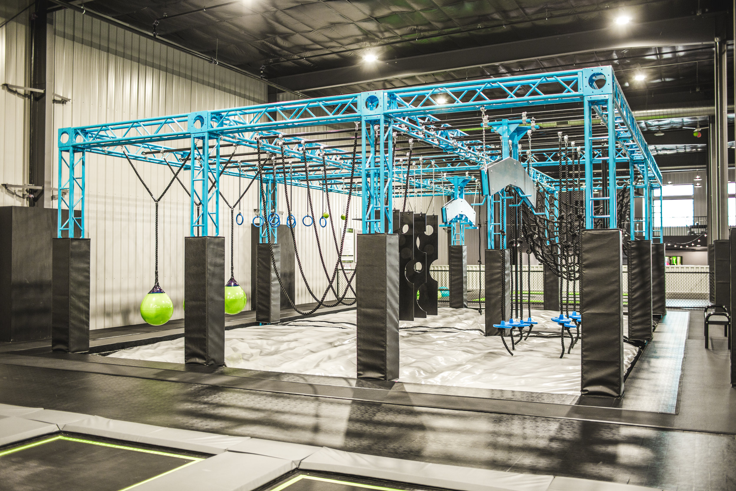 NINJA WARRIOR COURSE - Put your Ninja skills to the test in this 3 lane ninja warrior course that features 12 challenging obstacles!