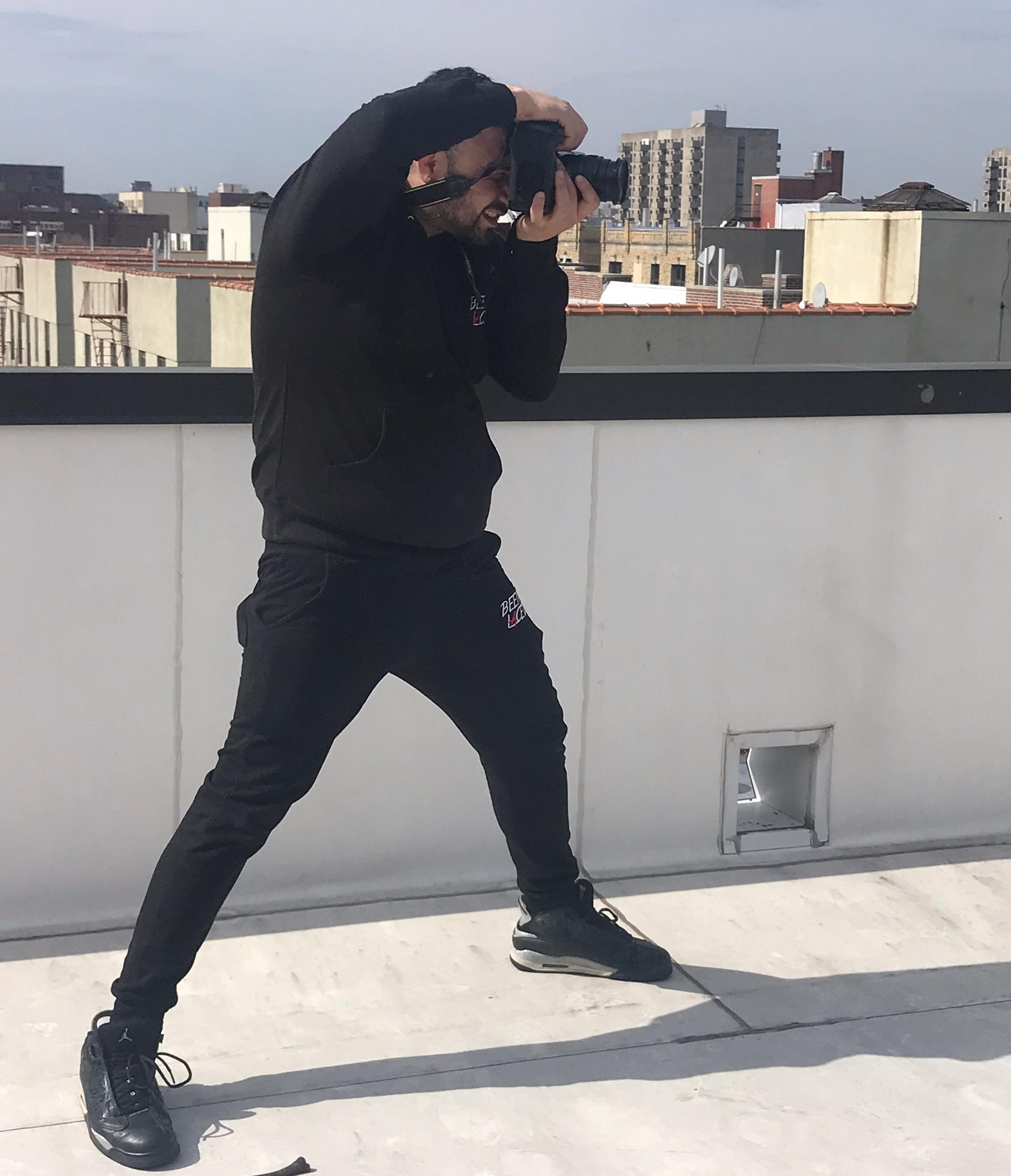Eddie Pabon during a rooftop photo shoot in the Bronx, New York | Courtesy of Jessie Paulino