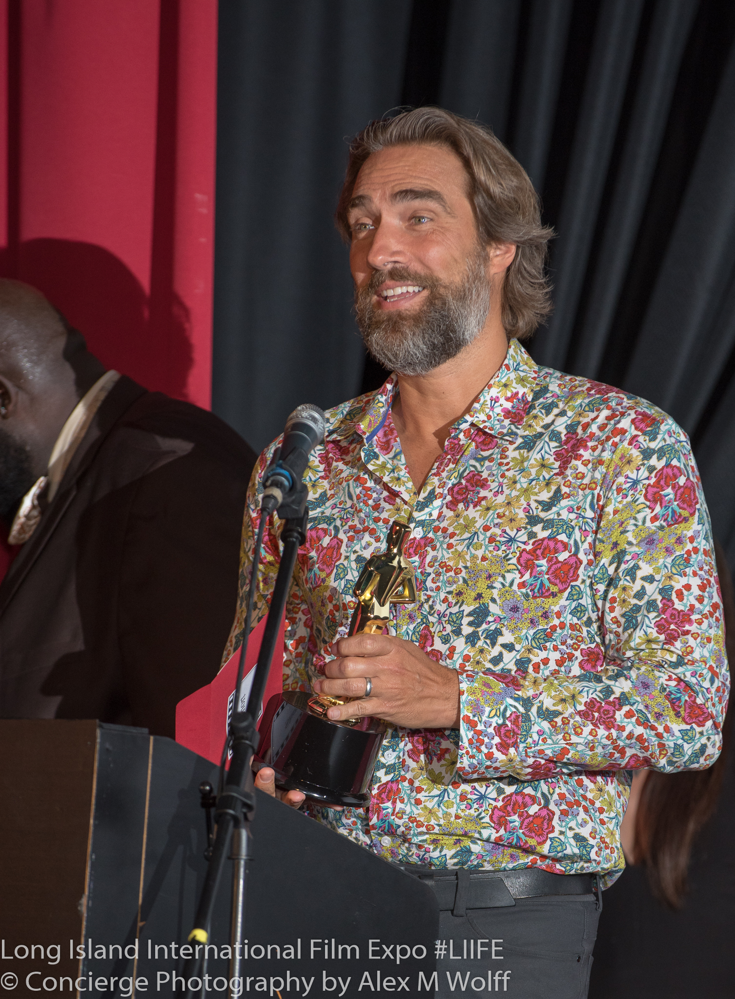 Lukas Hassel accepting his award at the Long Island International Film Expo