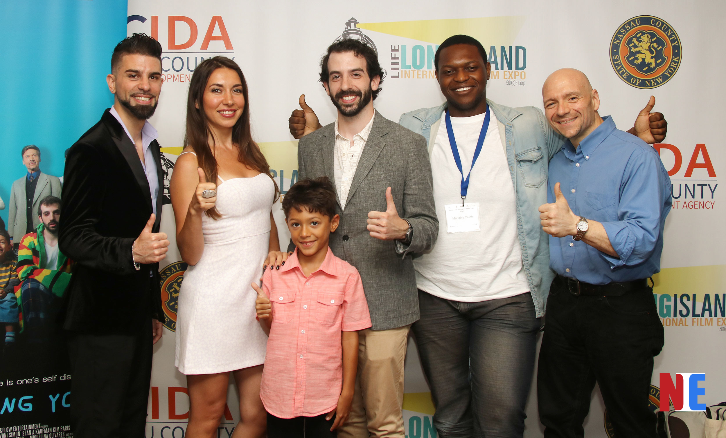 L-R Producer Chase Michael Pallante, actress Kim Paris, child actor Joshua Saint Leger, actor Sean A. Kaufman, writer/director Divoni Simon, and voiceover actor Michael Paladine attend the Long Island International Film Expo at the Bellmore Movies and Showplace in New York on July 12, 2019 |  Courtesy of NIE