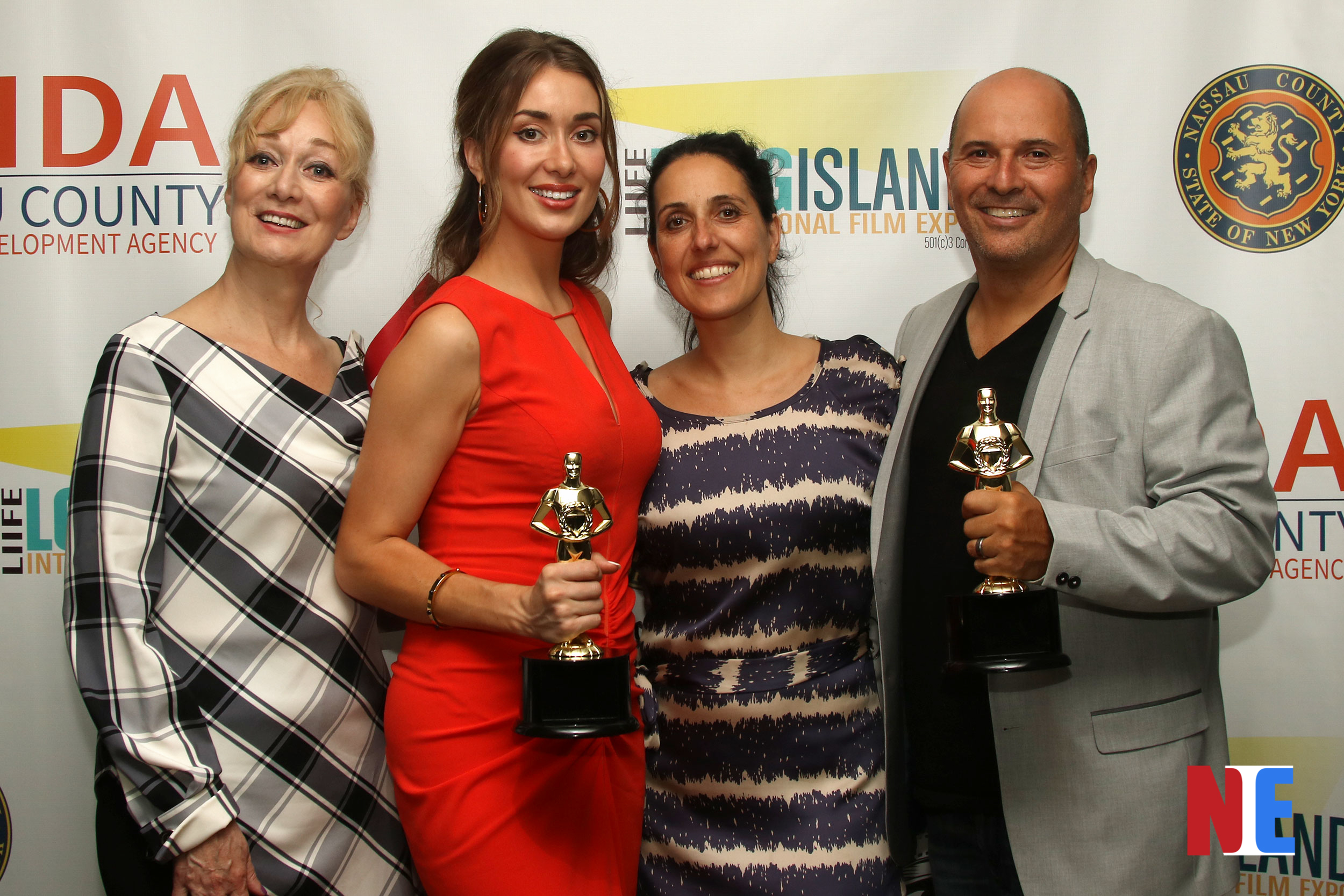 Verity East, Eli Hershko and guests on the red carpet winning the Jury Award for Best Feature Film at the Long Island International Film Expo inside the Bellmore Movies and Showplace in New York on July 18, 2019 |  Courtesy of NIE