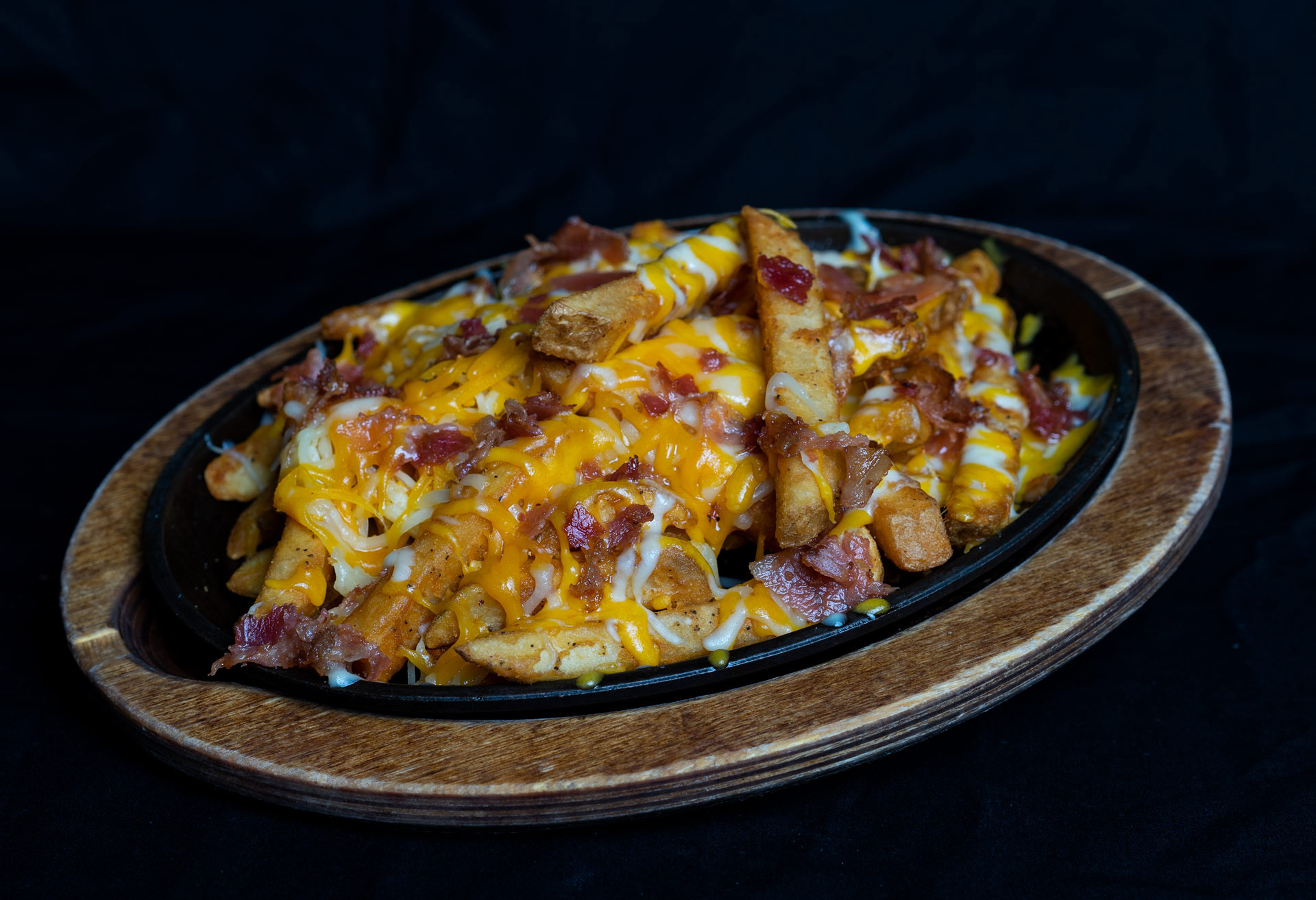 Bacon Cheddar French Fries A heaping order of French fries smothered with melted cheddar-jack cheese and topped with fresh hand cut hickory smoked bacon. 6.00