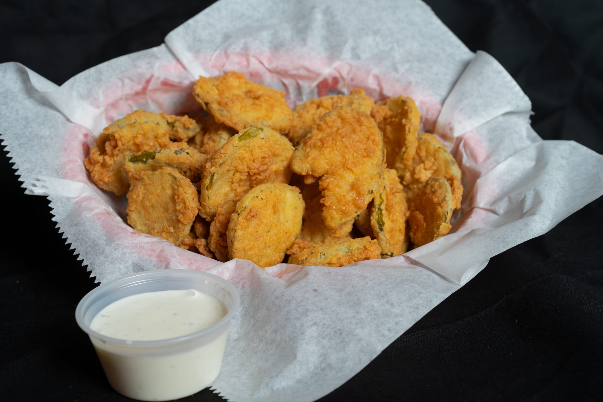 Southern Fried Pickles Hand breaded dill pickle slices deeply to a golden crisp and served with Ranch dressing. It's a southern tradition. 5.00