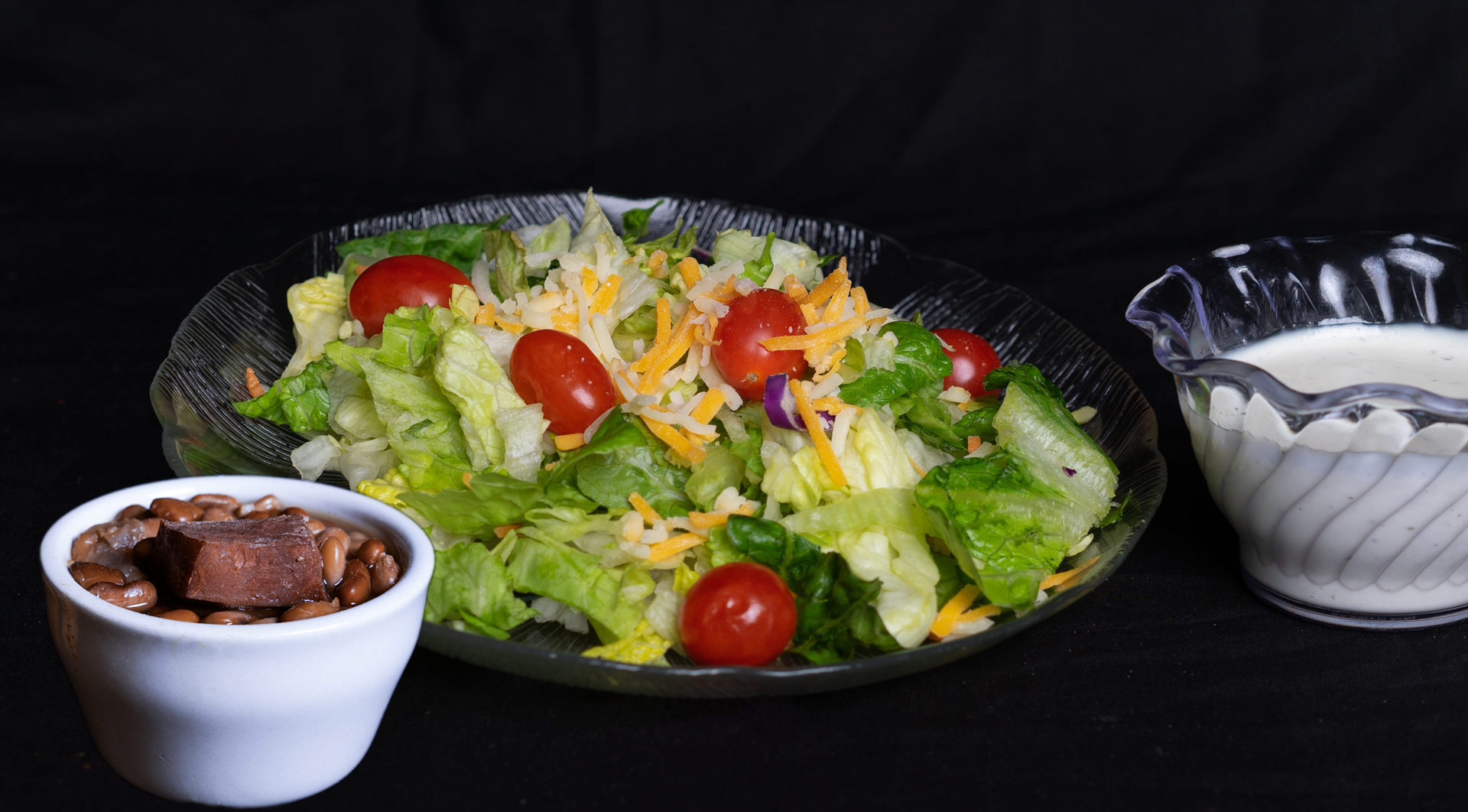 Build Your Own Bean and Salad Bar  Add to any entree for only 3.00 at lunch and 4.00 for dinner One trip salad bar only (does not include bean bar) 7.00 All You can eat bean and salad bar 10.00 Bean Bar with all you can eat hushpuppies, pickled green tomatoes, coleslaw, and onions 5.00