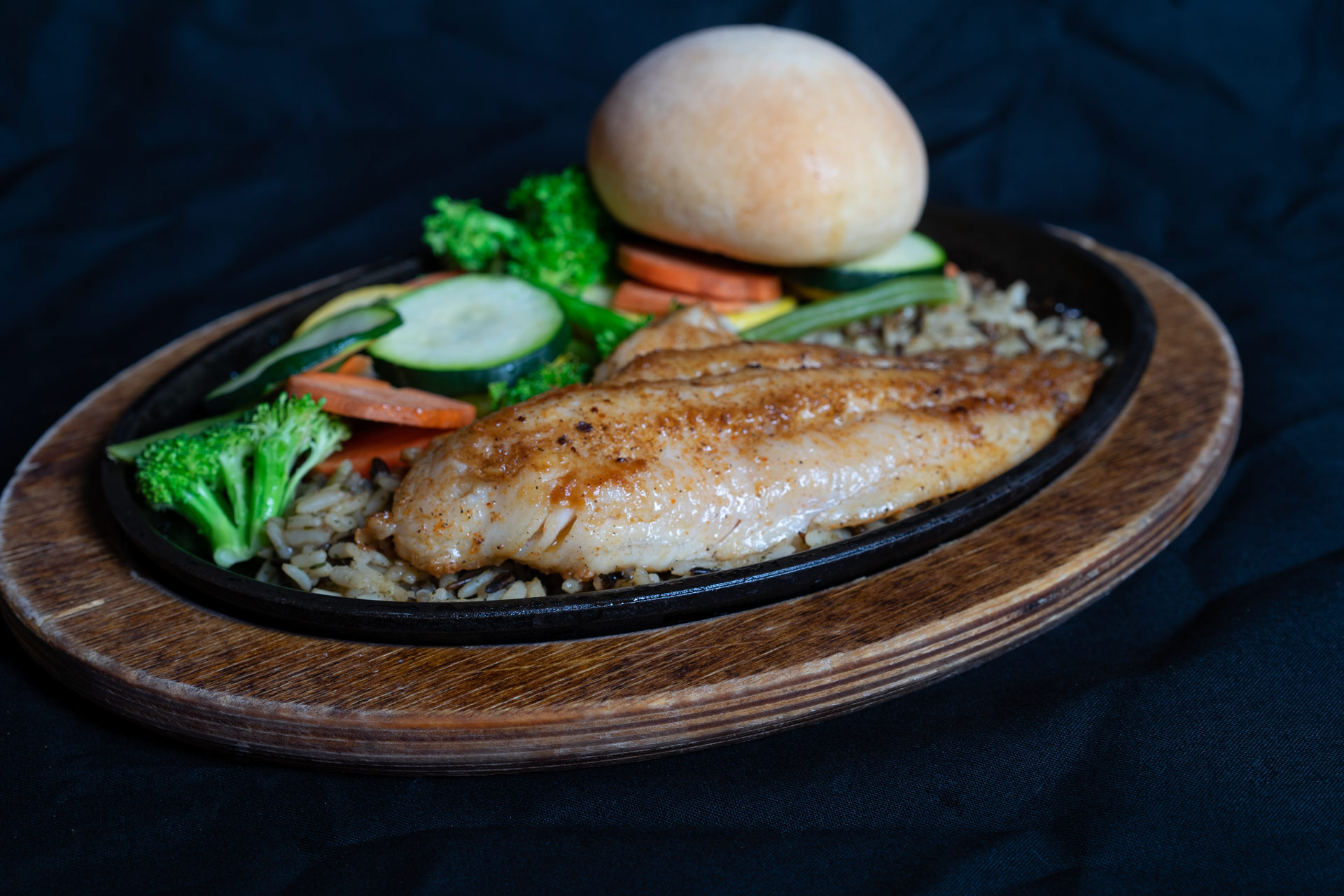 Grilled Catfish Pride of the Pond catfish fillets grilled, lightly seasoned, and served over wild rice with your choice of grilled or steamed vegetables and a house prepared yeast roll.  One Fillet 13.00 Two fillets 15.00