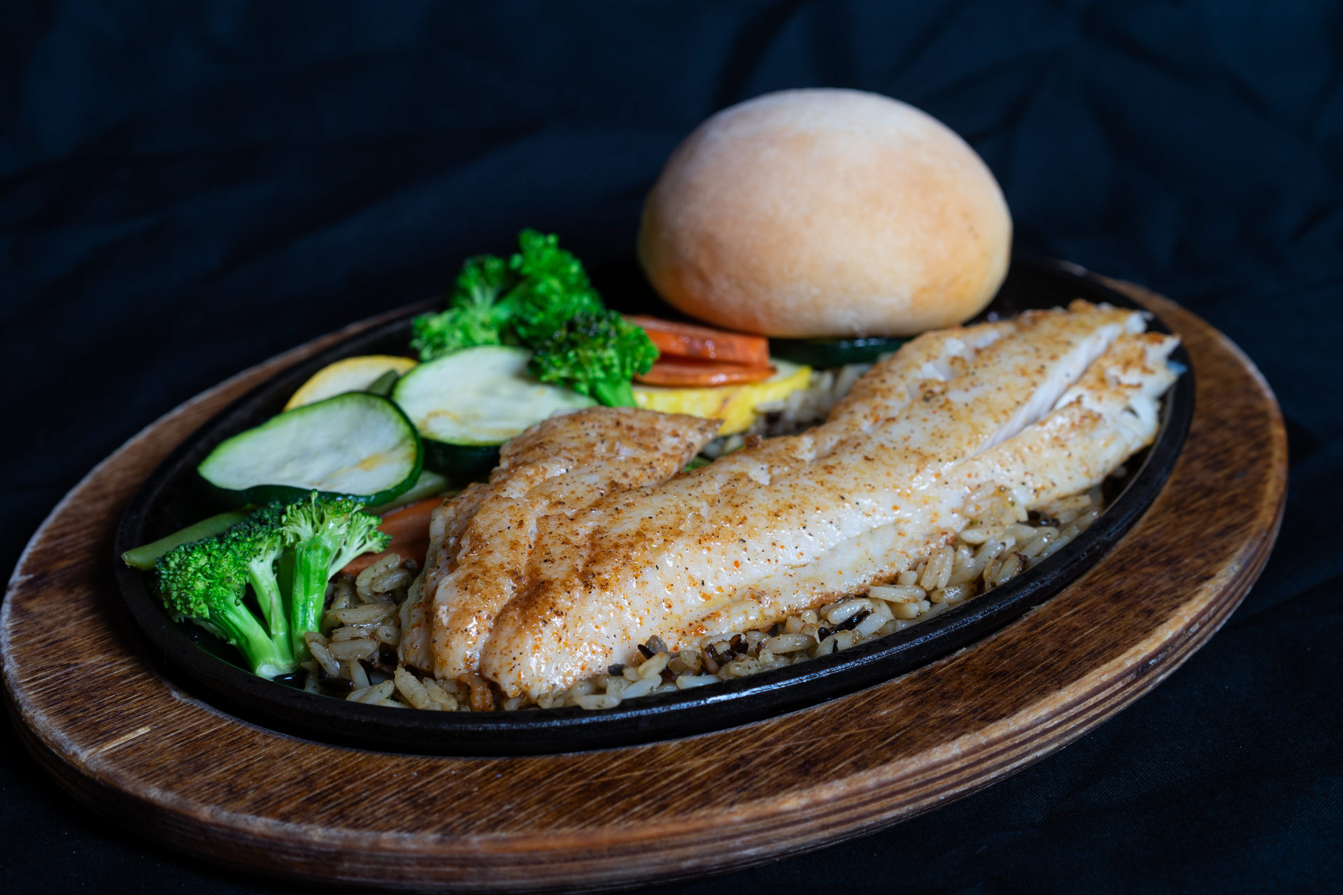 Grilled Walleye A flaky, sweet, succulent fillet served either grilled or fried over a bed of wild rice. Accompanied by your choice of grilled or steamed vegetables and a house prepared yeast roll. 17.00  (Click here to learn more about the Walleye)