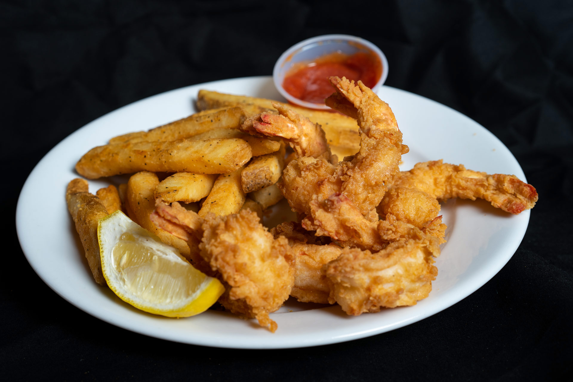 Deep Fried Jumbo Gulf Shrimp Hand breaded deep fried shrimp from the Gulf of Mexico. Served with french fries and cocktail sauce.  Nine Piece 14.00 Six Piece 11.00