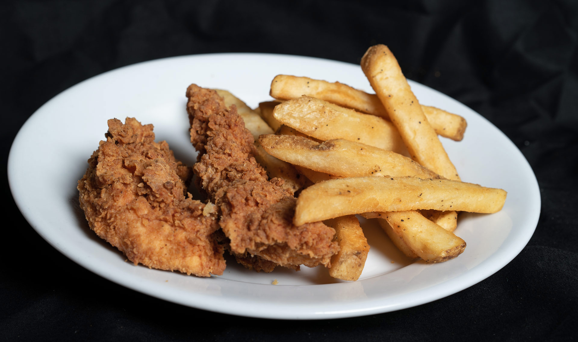 Chicken Tenders Fresh hand breaded chicken tenders deep fried to a golden crisp and served with french fries, Cole slaw and beans.  Two Tenders 8.00 Four Tenders 12.00
