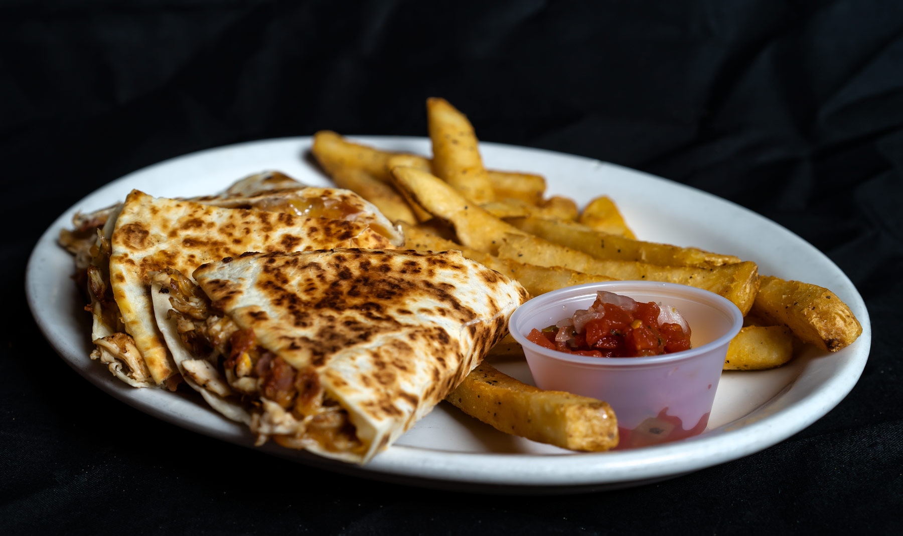 Chicken or Cheese Quesadilla Grilled Chicken breast, bacon, melted cheddar jack cheese served on a grilled flour tortilla with a side of Pico de Gallo.  Chicken 9.00 Just Cheese 7.00