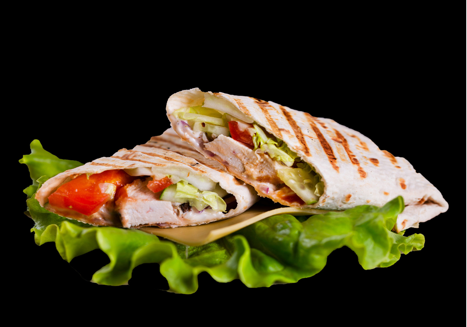 Chicken Wrap Grilled chicken, lettuce, tomato, cheddar jack cheese, bacon, and our homemade ranch dressing wrapped in a fresh garlic tortilla. Served with your choice of steak fries, french fries, onion rings, chips, or Texas Toothpicks. 8.00