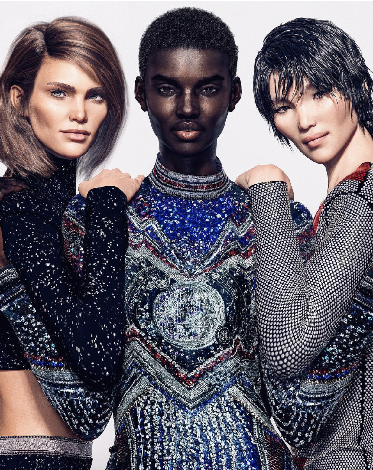 I'm not sure these models was what he said were aliens, but these models are virtual and created by Balmain.