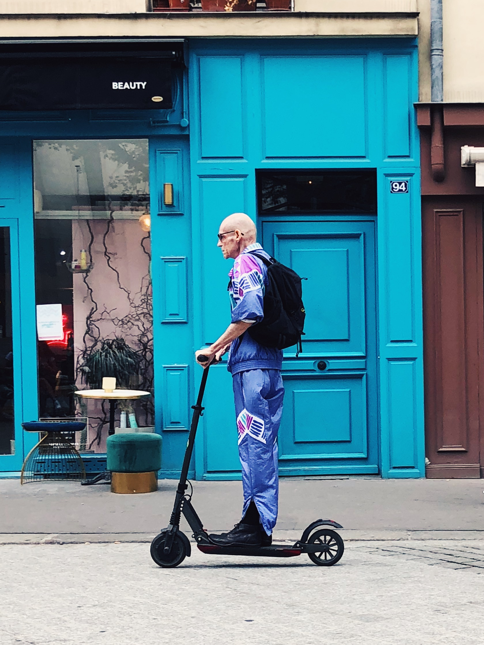 Old-man-riding-scooter.JPG