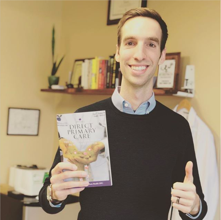 2018.12.01 Dr Paul Thomas with Printed copy of Direct Primary Care the Cure for Our Broken Healthcare System.png