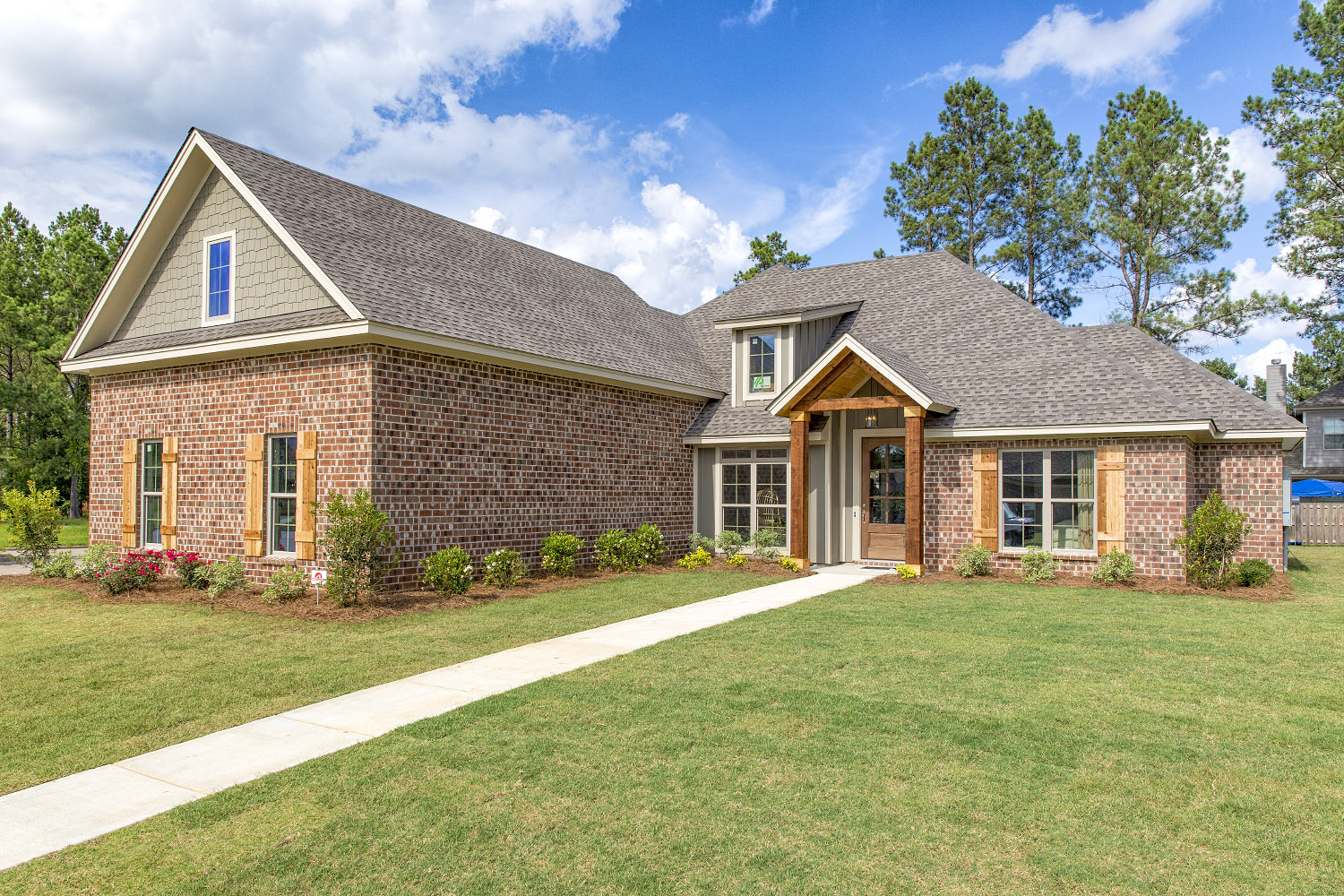 Well manicured flower beds, fresh pine straw, and freshly cut grass make all the difference