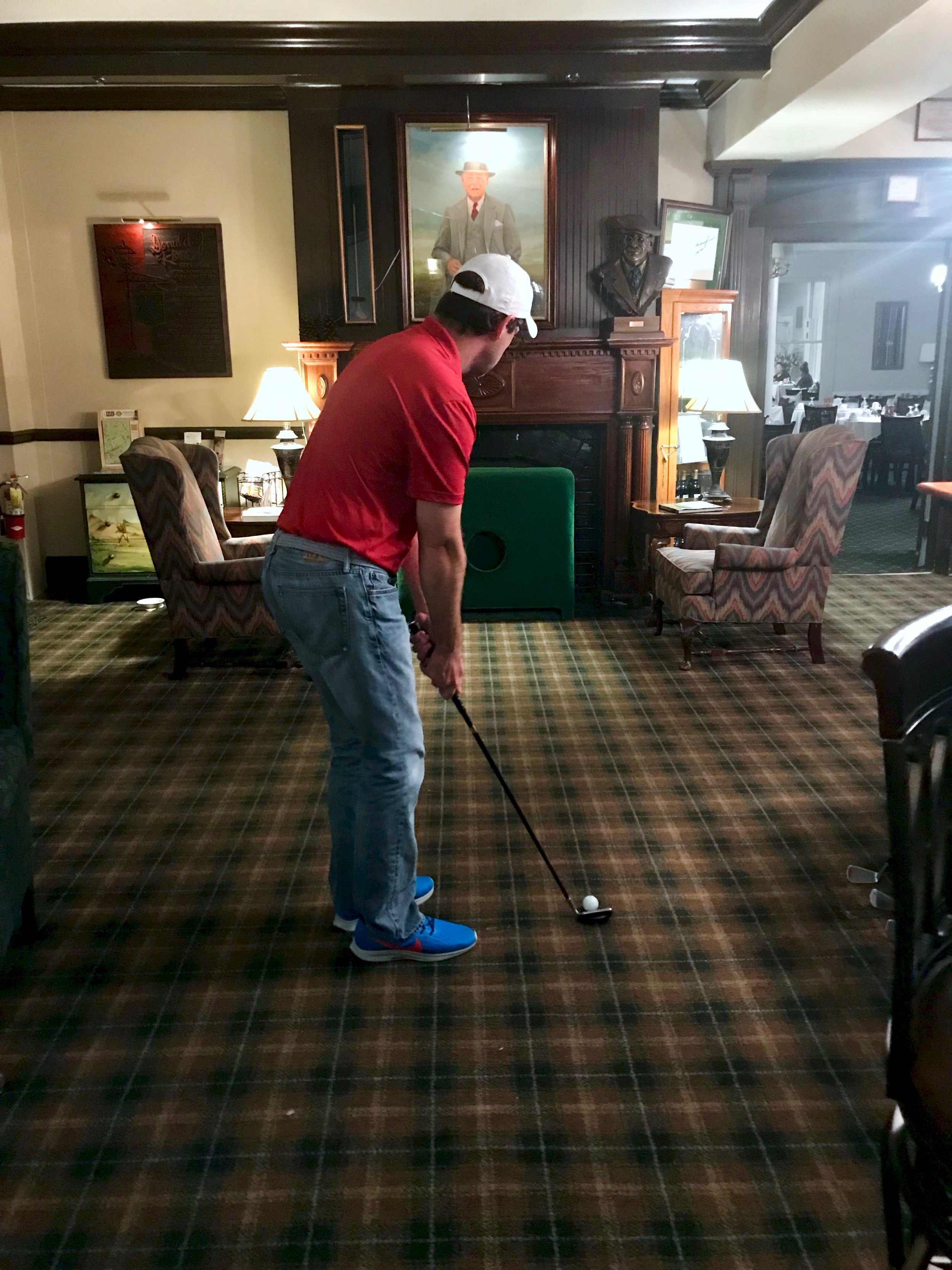 The author, in his blameless chipping stance, in the lobby of the Pine Crest Inn in Pinehurst, N.C.