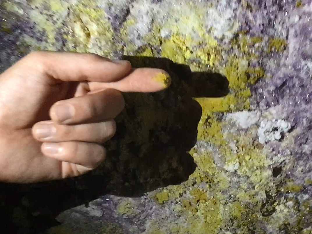 The yellow stuff is sulphur... the purple crystals are a form of gypsum.