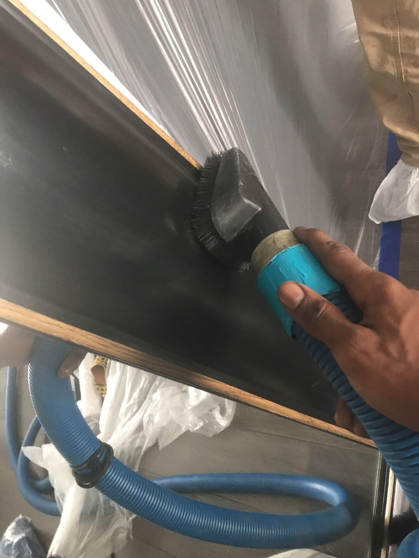 technician HEPA-vacuuming contents