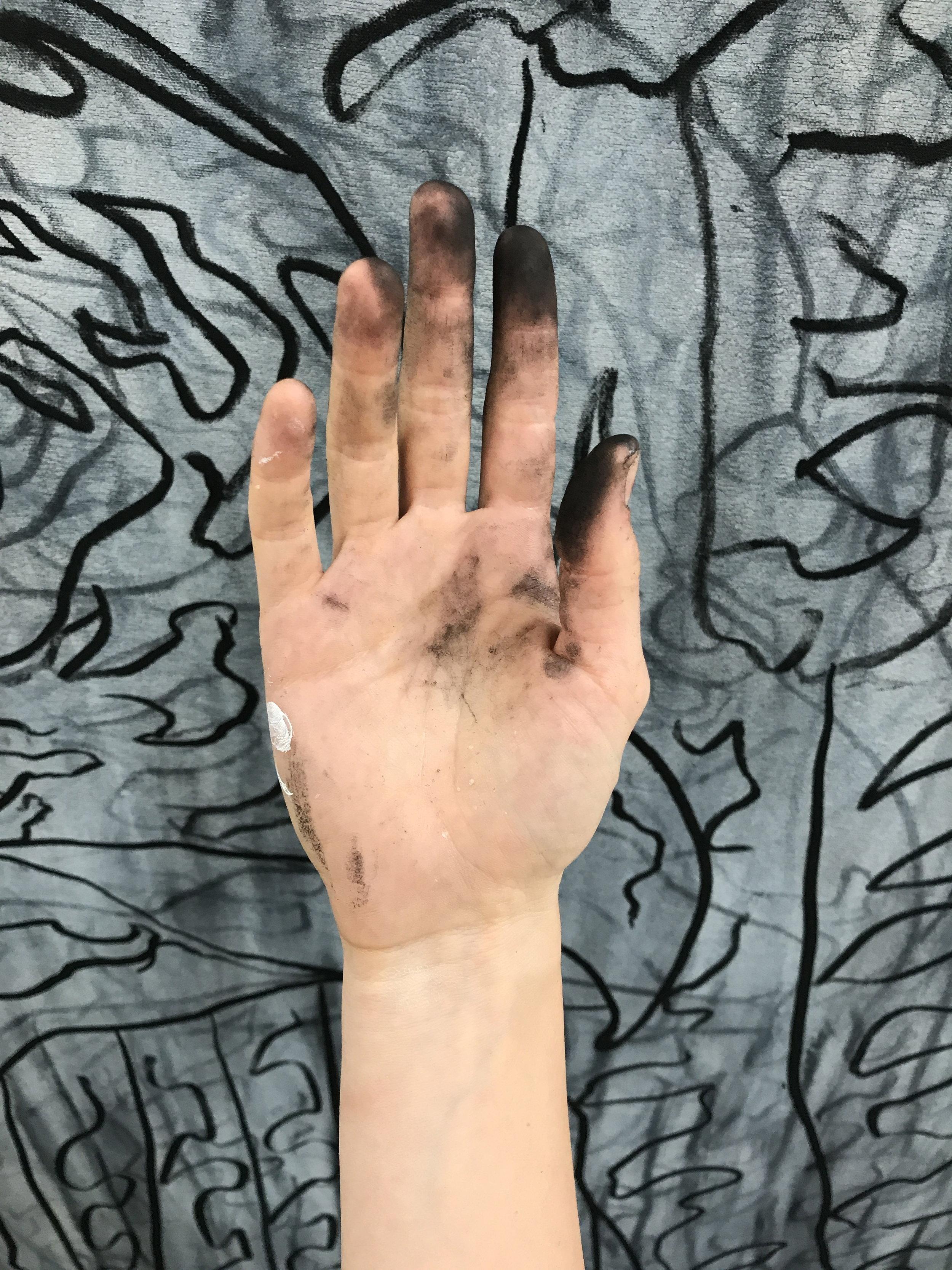 charcoal hand.jpg
