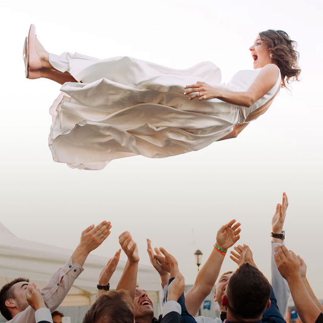 Bride being thrown into air