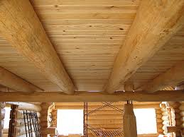 """Interior loft view - The loft system consist of 10"""" logs for the joists, covered by 2x6 t&g loft boards. This is a very nice, rustic, fast  and affordable way of building the second floor loft area."""