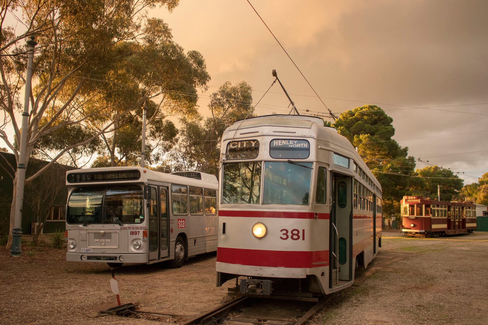 MAN SL200 no.1897 in ORIGINAL STA SILVER LIVERY poses for a photo in the MUSEUM YArd with Trams No. 381 & 264