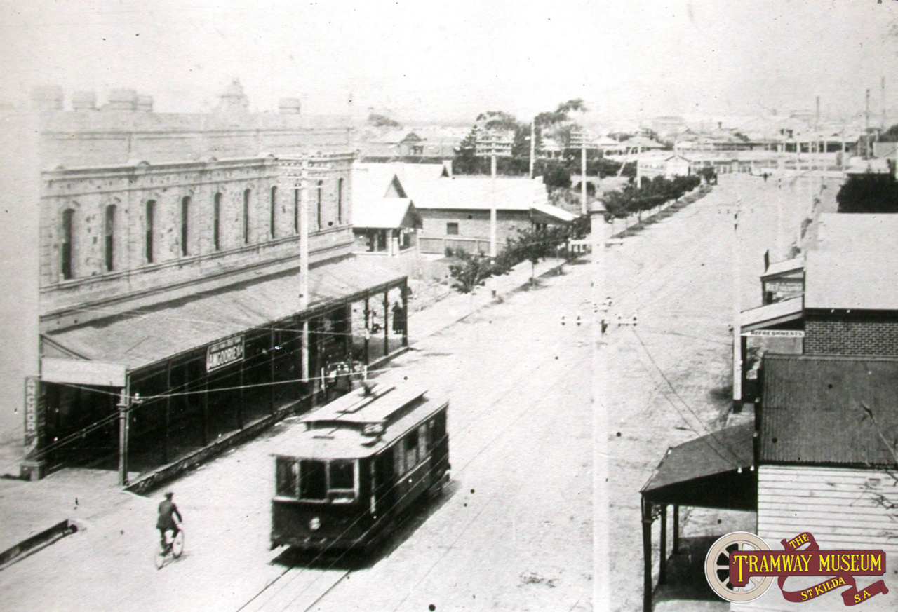 Seen from the balcony of the Largs Pier Hotel, a tram has just left the Largs terminus next to the hotel and is running along Jetty Road on its way back to Port Adelaide. Photo: 1920s postcard.