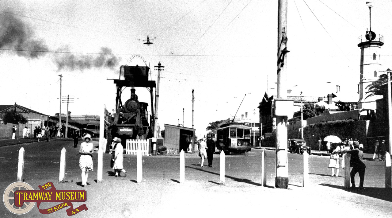 A railway had been running down the middle of Semaphore Road since 1878 but after 1917, the thoroughfare also contained the tracks of the local tramway system. A tram towards the right of the photo has just departed from the terminus in The Esplanade and is climbing up the short gradient at the end of Semaphore Road in the 1920s. Photo: Murray Billet Collection.