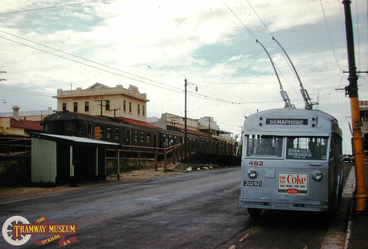 In April 1961, a special tour of the trolley bus system was held by the AETA with a trip to Semaphore being part of the trip. Seen here at the Semaphore terminus is the tour bus with a 'Redhen' suburban railcar set seen in the background. Photo: John Radcliffe.