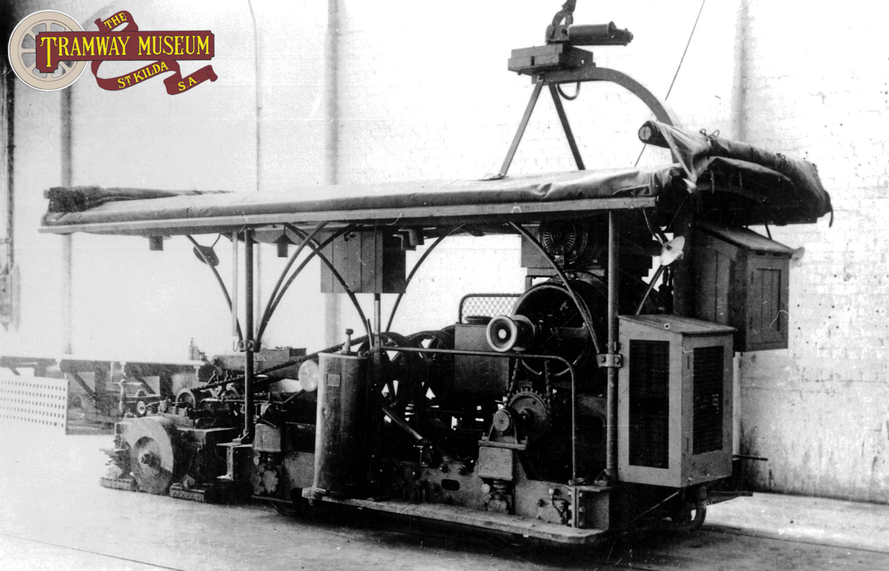 A unique 'one off' in the Adelaide tram fleet was tram 38 which was converted to a Ballast Motor. Originally built in 1909 as one of the B type toast rack trams, 38 was converted to a running flat bed to transport rails and other track materials for the conversion of the Glenelg line to a tramway in 1929. During the Second World War, it was converted to hold a large tank of diesel fuel and was also made an unpowered vehicle. Seen here in storage in the 'Southern Annex' of Hackney depot, 38 is seen awaiting final disposal in the early 1950s.