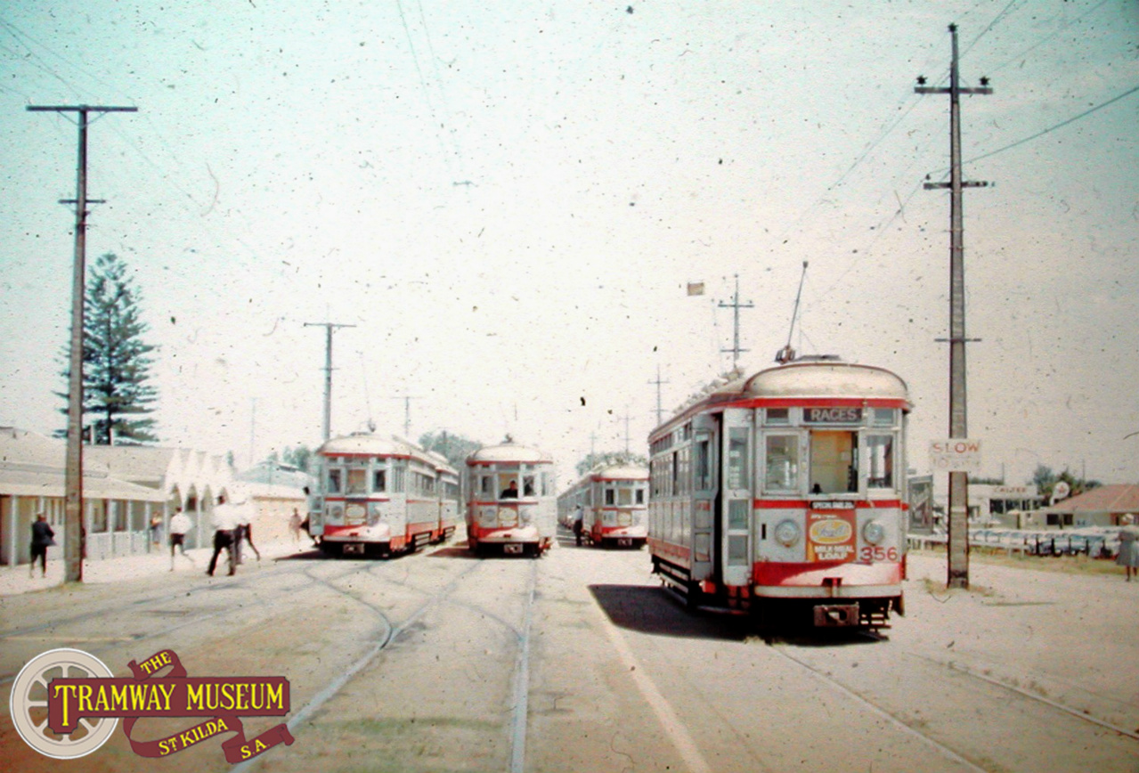 Morphettville Racecourse in the mid 1960s sees trams to and from Glenelg stopping at the entry gates. Additional trams can be seen on the siding to the right, waiting to return punters back to the City. Photo: Barry Marshall.