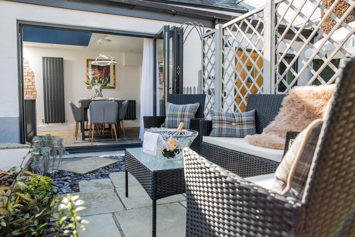 Garden - Outside there is a choice of seating areas including a terrace with large table and chairs with BBQ.