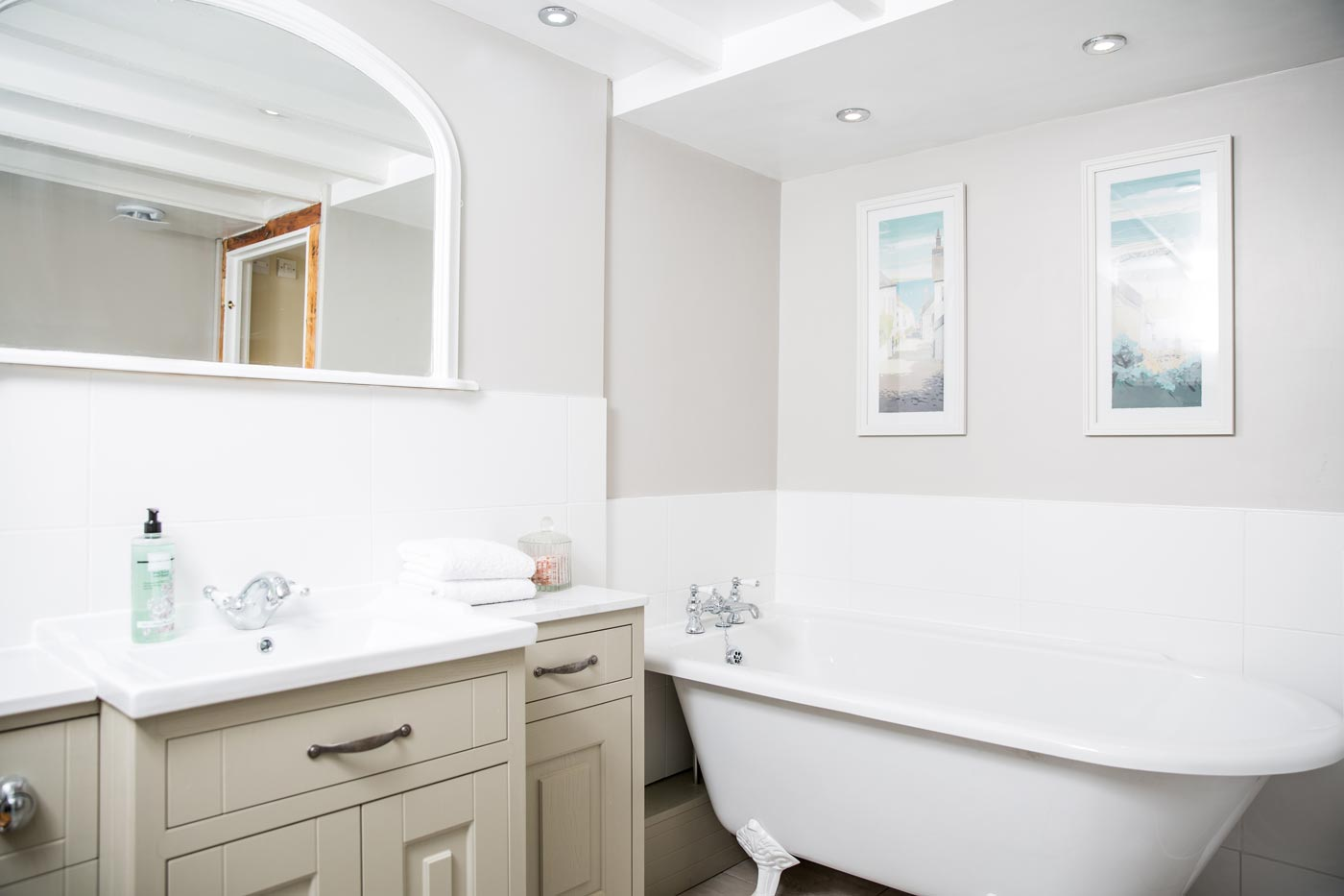 Stylish Family Bathroom - The family bathroom is situated on the ground floor with underfloor heating, a roll top bath and separate shower.