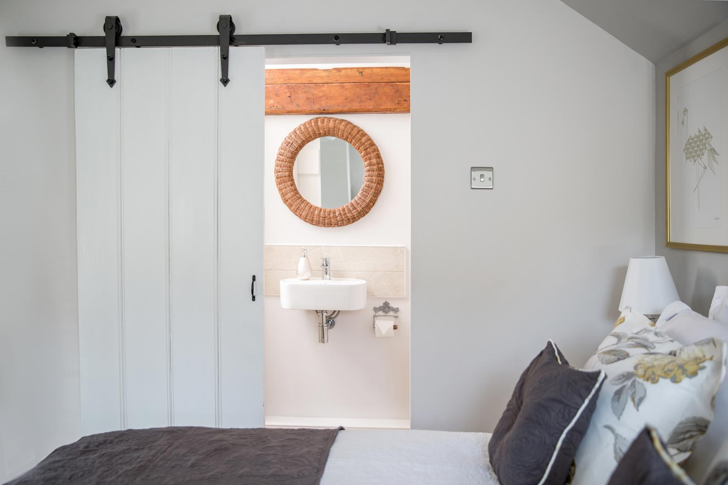 A sliding door leads you to the ensuite shower room in master bedroom