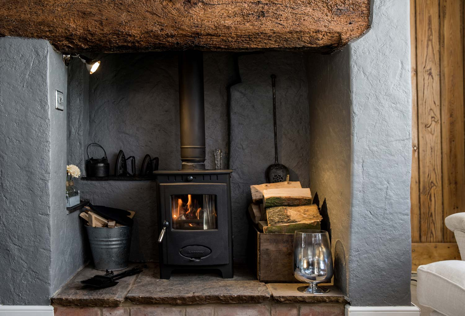 Cosy Log Burner - The historic inglenook fireplace gives its name to this stylish retreat