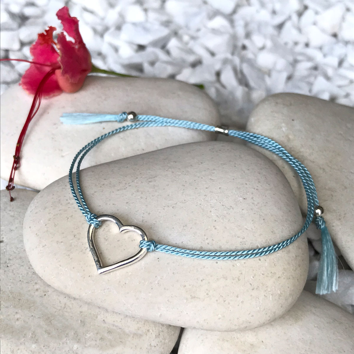 - Silver and Silk BraceletsElegant bracelets made with 100% silk and sterling silver/rose gold vermeil-style sourced from ThailandThe bracelet is slipped onto the wrist and uses a sliding hourglass bead for closure