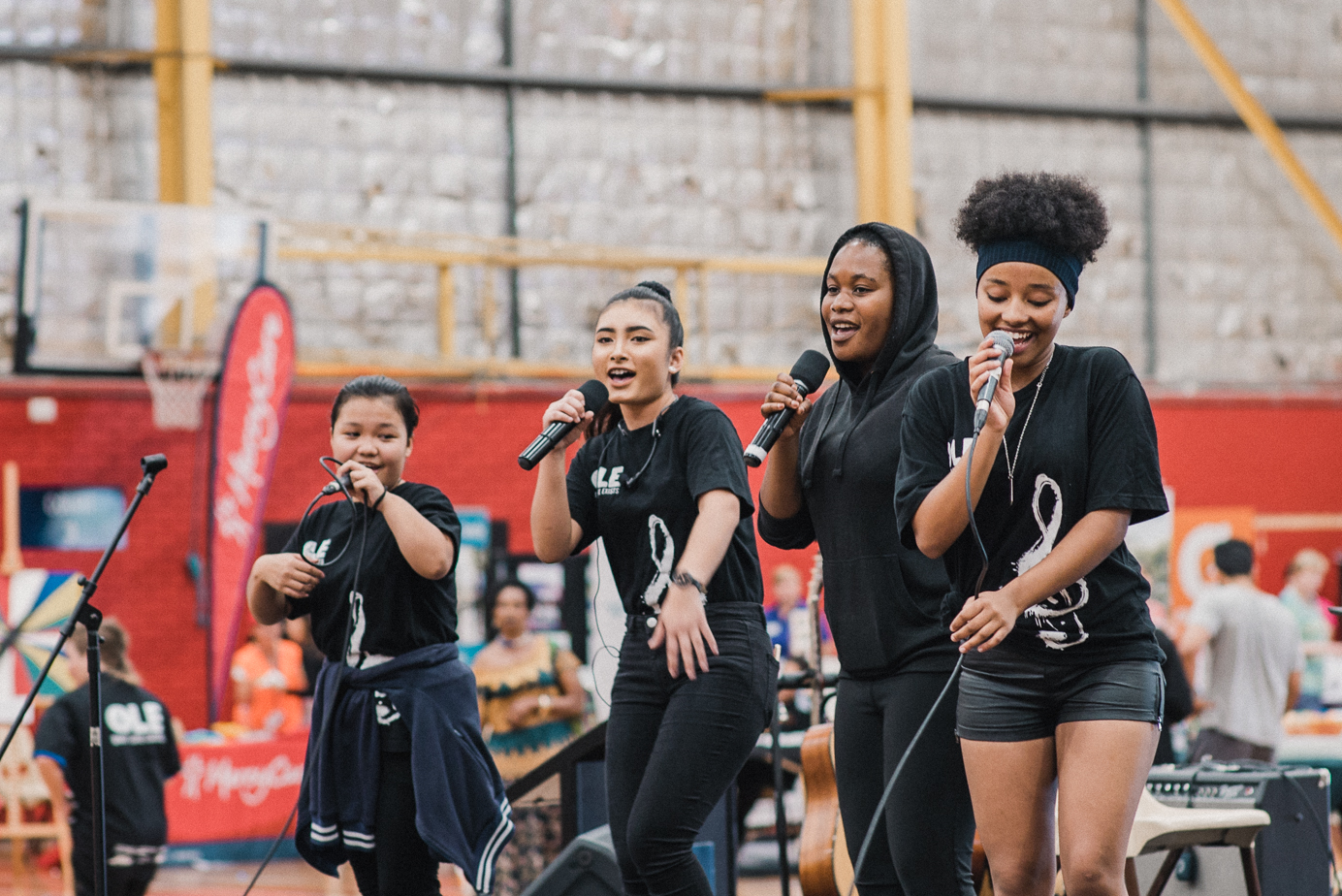 O.L.E. rapping at Mirrabooka Harmony Day Festival 2019