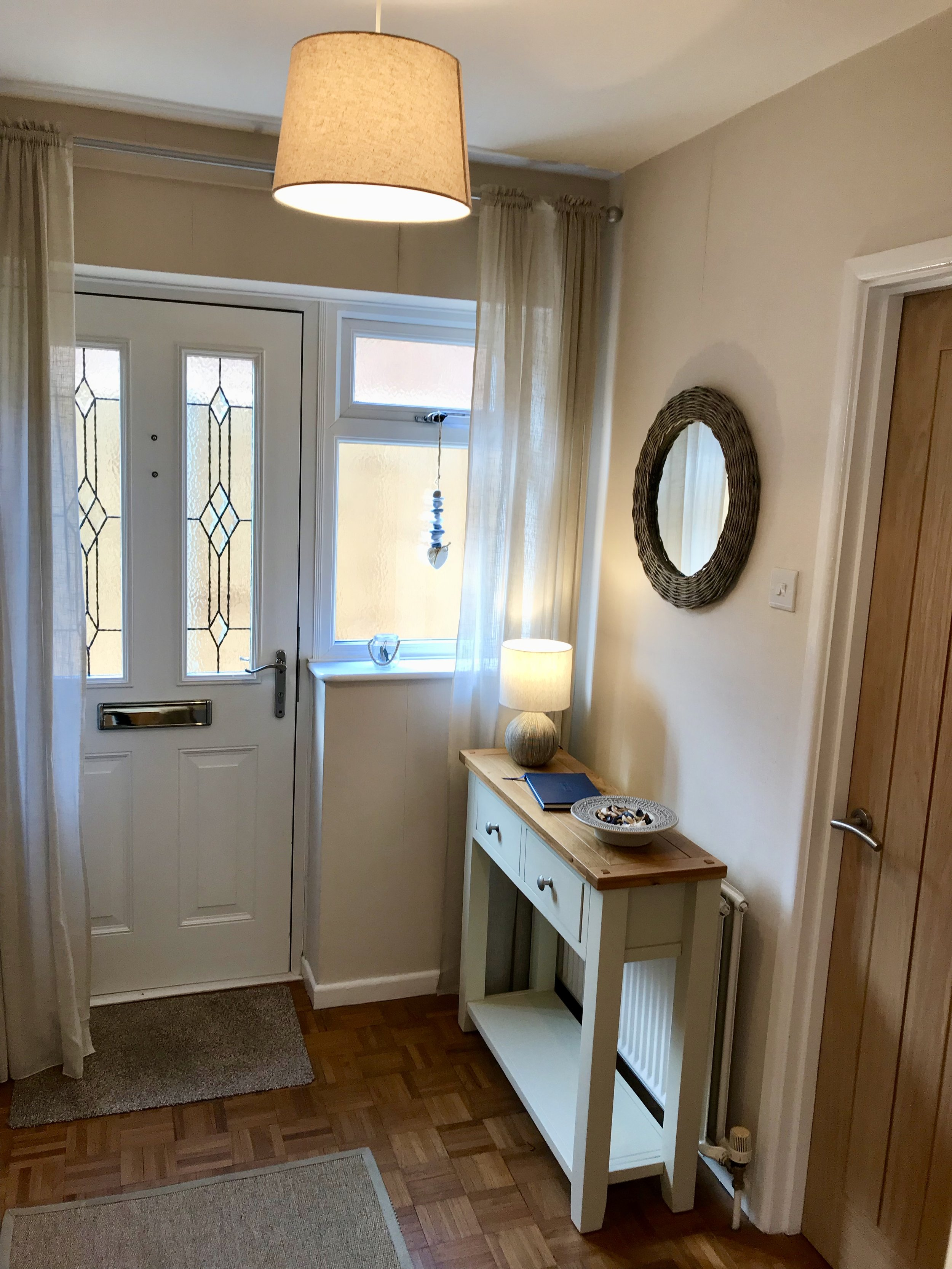 Entrance Hall - Access to the bungalow is via the entrance hall to the side of the property.The hall cupboard provides hanging space for coats and contains cleaning equipment, an iron and an ironing board.The bungalow has guest controlled central heating and free Wi-Fi.