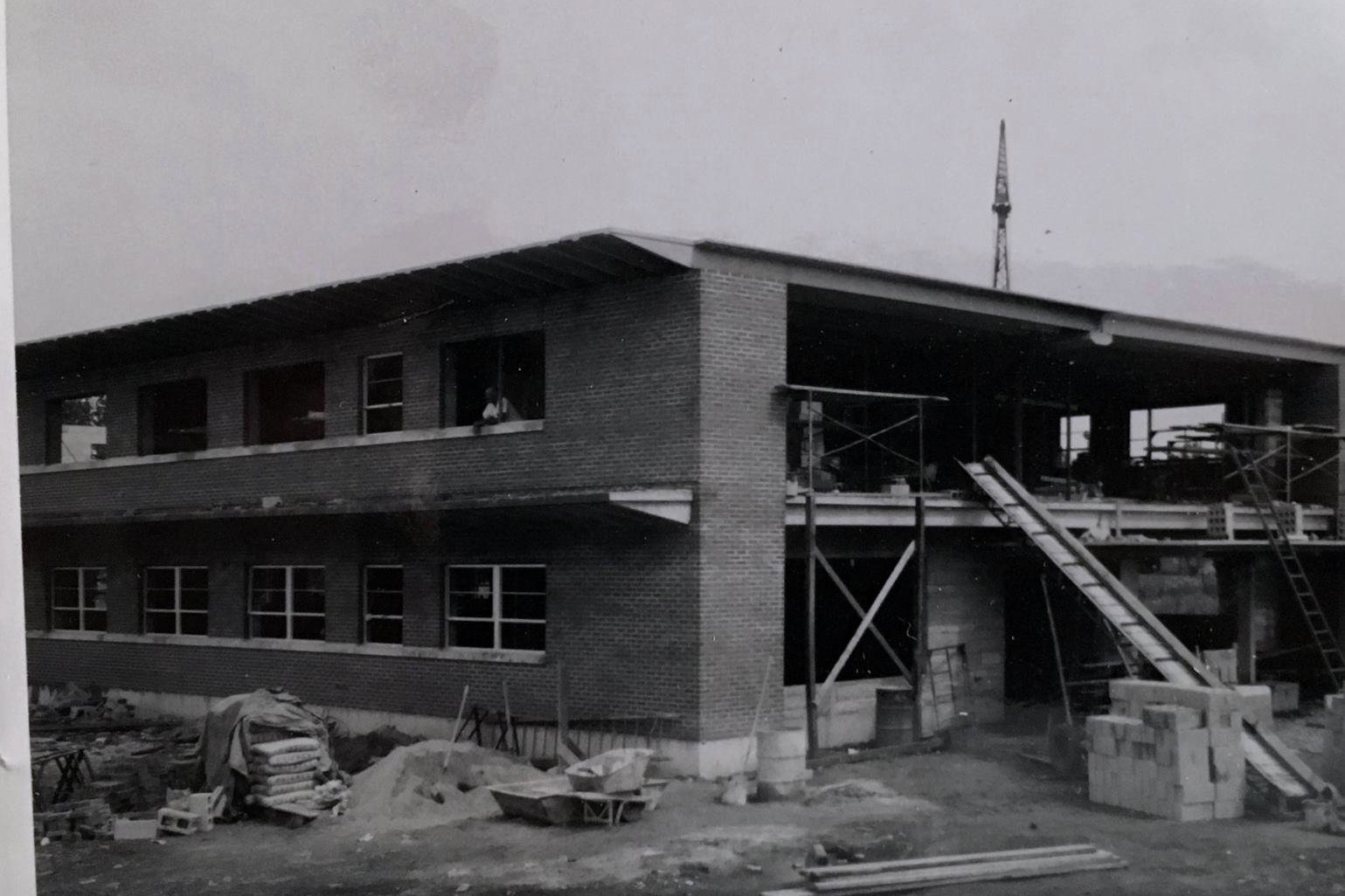 The Johnson, Depp & Quisenberry building under construction in June of 1958. This view is looking at the front north-west corner of the building.