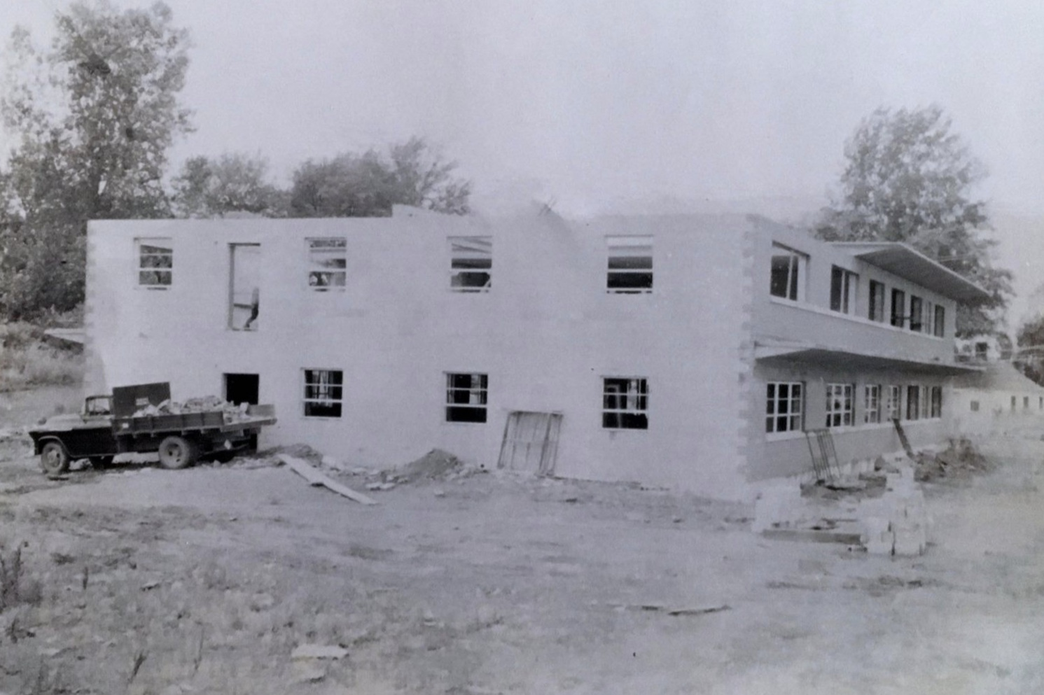 View of the east and north sections of Johnson, Depp and Quisenberry in June of 1958. Not that the majority of the Double-T concrete roofing system have been installed. The door in the upper left-hand corner was the fire-escape.